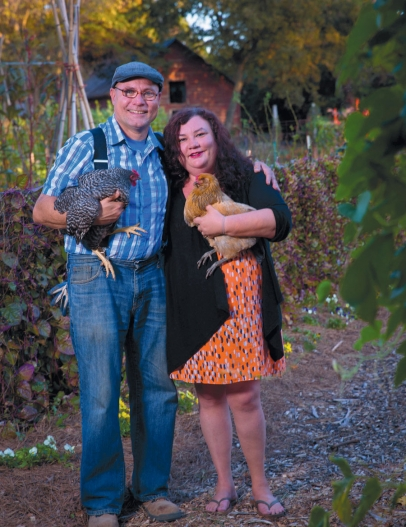 Tri Cycle Farms founder Don Bennett with his partner, Kelly Bassemier, and two of their chickens, Lefty and Daisy.