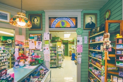 interior of Olde Fashioned Foods includes the original fireplace, antique accesories, and stained glass windows