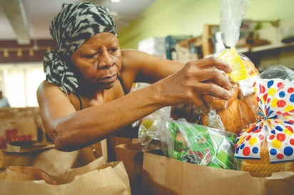 Charolette Tidwell packs bread for donation