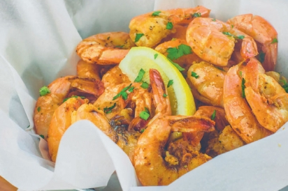 a bucket of peel-and-eat shrimp