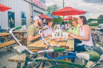 people sharing a meal at Blu Bentonville Fresh Fish Marketplace
