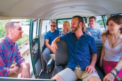 people on hogshead tours van