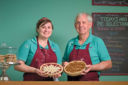 Sarah and Jerry Leding, holding a cherry pie and Dutch apple pie with salted carmel