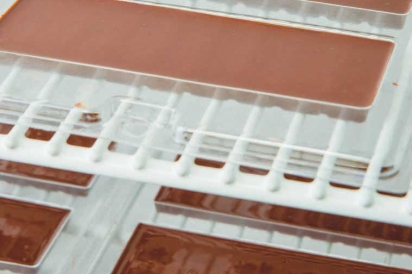 chocolate bars drying in molds