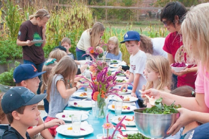 children set a table outside