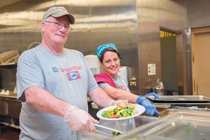 Joe Dukeshire, the Samaritan Cafe chef, and Leslie Tucker serve up plates of nutritious food