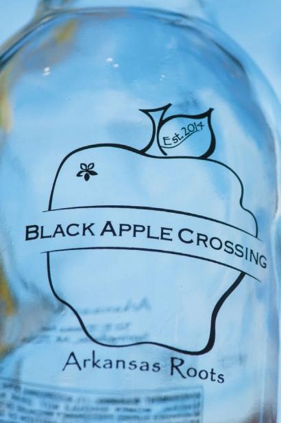 black apple crossing logo