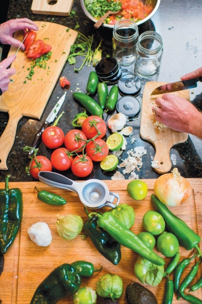 chopping and cutting vegetables for salsa
