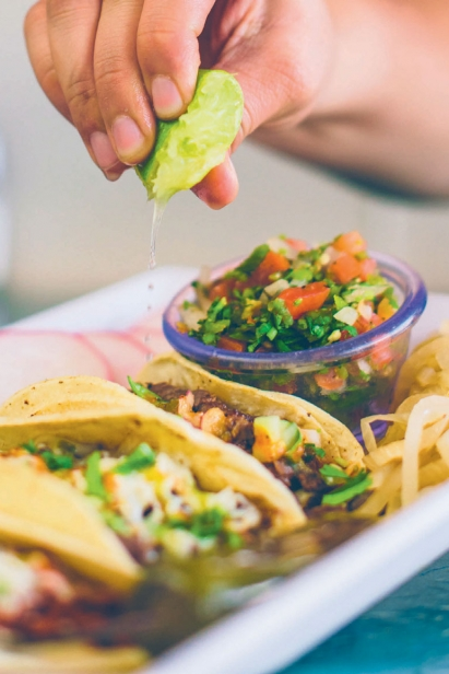 Alex's taco alambre has al pastor and asada, bell peppers, onion, and cheese.