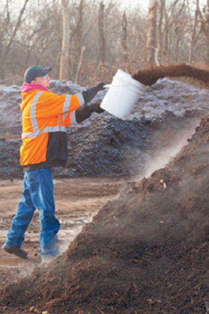 Enzymes are thrown onto the pile to start the Modified Static Aerobic Pile composting process